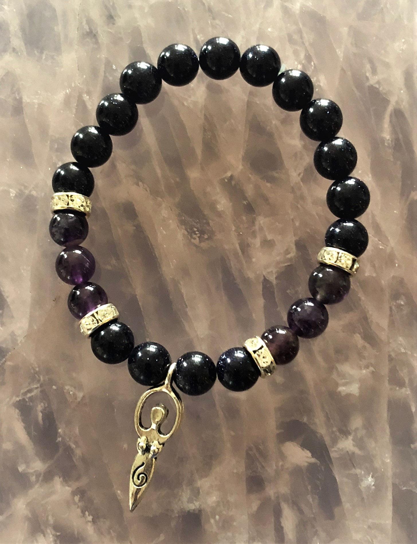 Ameythyst and purple goldstone bracelet with female charm